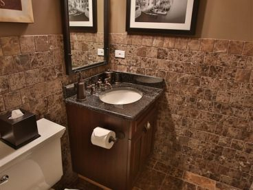 bathroom with vanity and brown accents