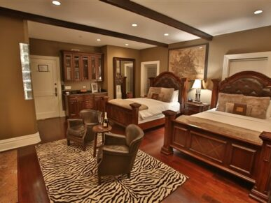 bedroom with 2 beds, 2 chairs