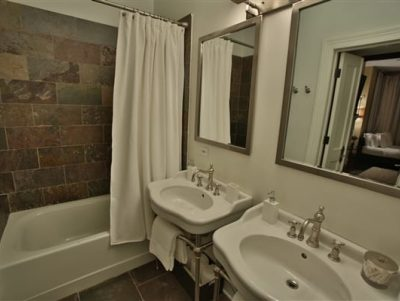 double vanities and tub in bathroom