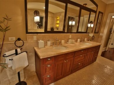 Two vanity sinks in bathroom and large mirror above
