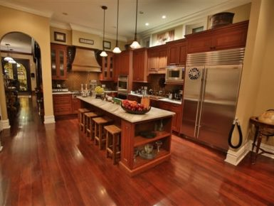 kitchen with island with stools