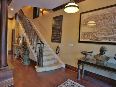 Villa D'Citta entry foyer with staircase leaving upstairs