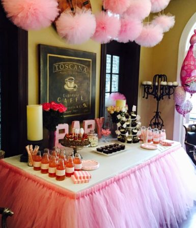 baby shower with many pink decorations