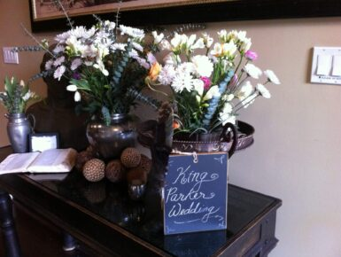 A flower bouquet at the entrance of a couples wedding