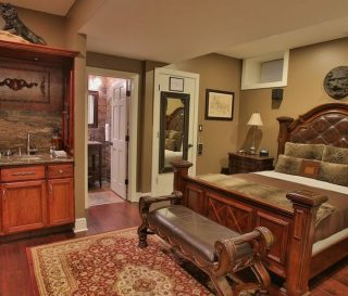 Caesar's lair bedroom is laid out with wood floors a granite counter top and a nice made up bed