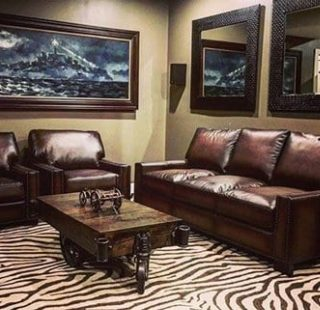 lounge area with sofa and 2 chairs