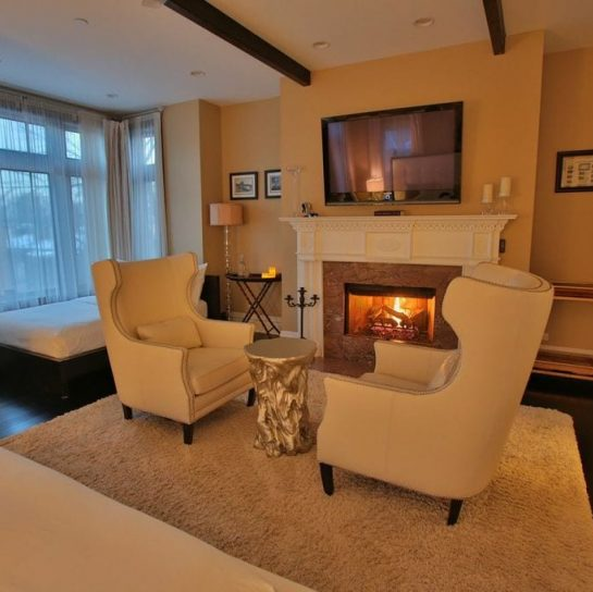 The Milan Suite fireplace and room decorated in a cream white