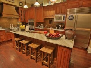 Kitchen featuring island with stools
