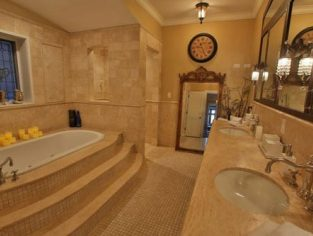 The bathroom is luxurious with jacuzzi tub and 2 vanity sinks