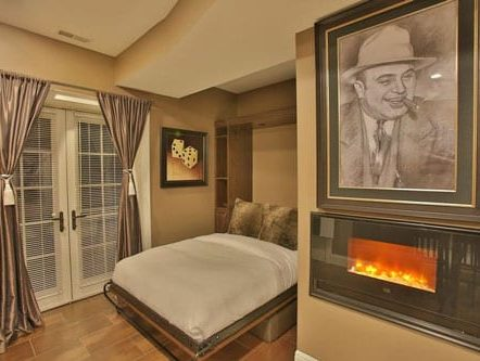 A fireplace nearby the bed